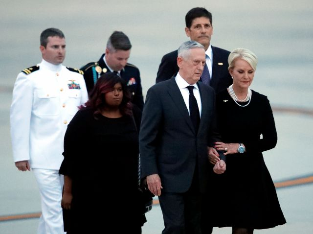Cindy McCain walks with Defense Secretary Jim Mattis, followed by children Jack, Bridget, Jimmy and Andrew Thursday, Aug. 30, 2018, as the plane carrying the body of Sen. John McCain, R-Ariz., arrives at Andrews Air Force Base, Md. (AP Photo/Alex Brandon)