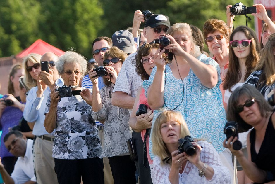 Family and friends get their cameras ready as the class of 2014 begin the procession at the start of commencement ceremonies at Cheshire High School, Tuesday, June 24, 2014. | Dave Zajac / Record-Journal