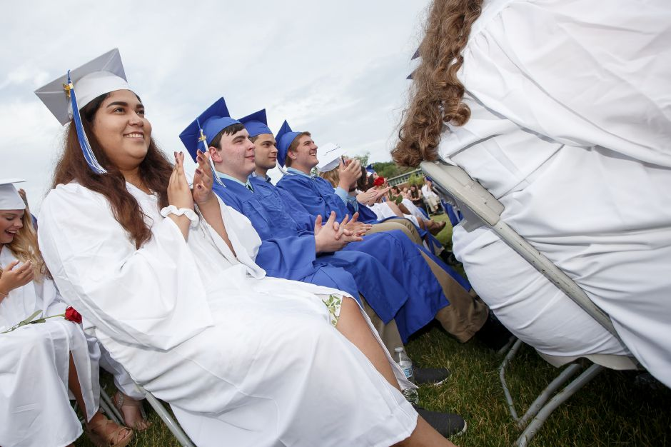 Graduates applaud the Mayors performance Friday during Lyman Hall High School