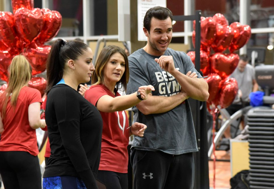"The Edge trainer Lindsay Boyles teaches former ""The Bachelorette"" contestant Matt Munson and fellow Meriden resident Noel Tufano how to do the heart-shaped circuit together on Tuesday, Feb. 13, 2018. Tufano entered the sweepstakes to workout with Munson by donating to the Boys & Girls Club of Meriden, where Munson has coached basketball for 12 years. 