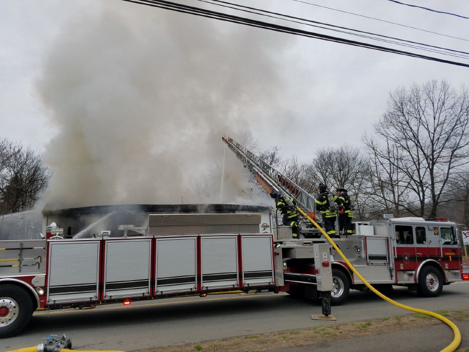 Firefighters are battling a fire at an industrial recycling facility on Hall Avenue. | Lauren Sievert, Record-Journal