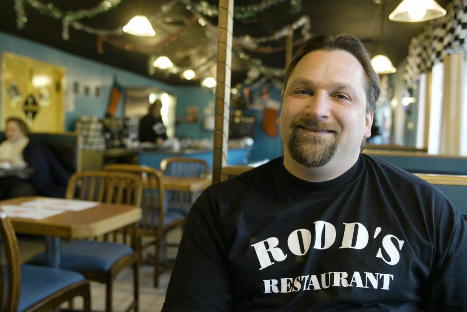 Rodd Legnani sits in booth in his new diner, Rodd