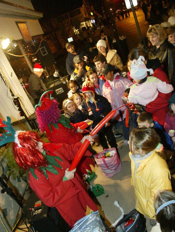 Some elves make balloon figures for kids at the 15th Annual Christmas in the Village of Plantsville on Dec. 1, 2005.