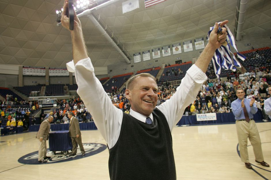 FILE PHOTO – Maloney coach Howie Hewitt celebrates after winning the 2008 CIAC Division L Championship game against Lyman Hall at Gampel Pavilion in Storrs CT March 15, 2008. (dave zajac photo)