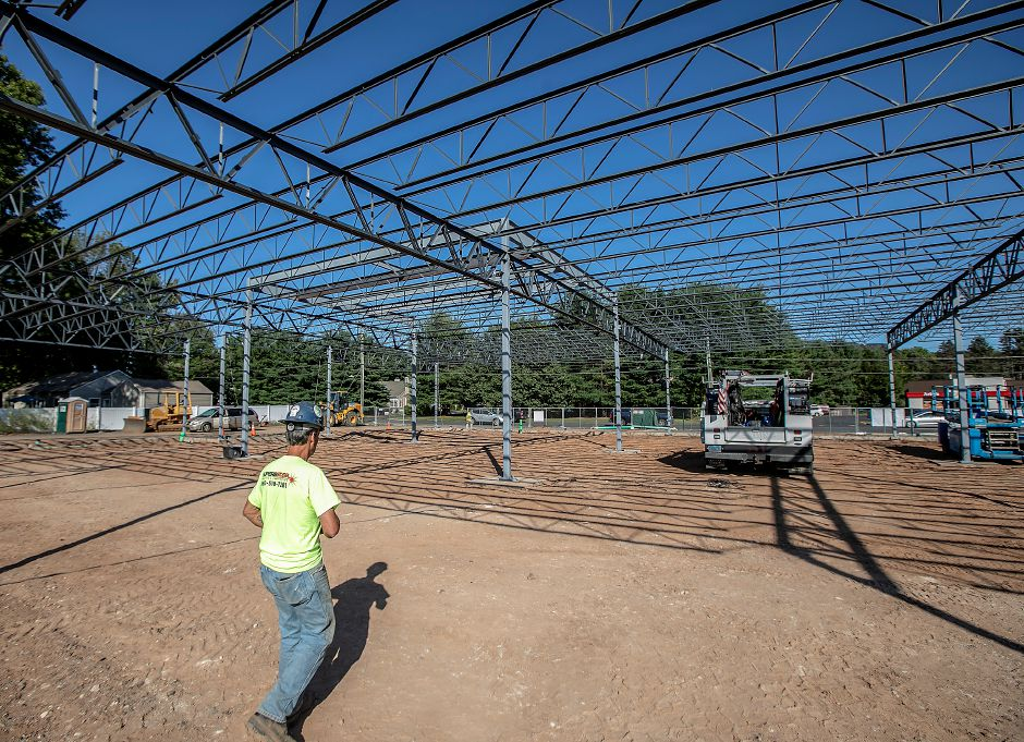 Bob Mathiau, a worker for New Britain based Superb Steel, walks to his vehicle as construction continues on the new Tops Market in Southington, Thurs., Sept. 19, 2019. Dave Zajac, Record-Journal