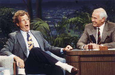 Talk show host David Letterman, left, gestures while talking with Johnny Carson during taping of the ?Tonight Show? at the NBC Studio in Burbank, California on August 30, 1991. Letterman?s presence on the ?Tonight Show? was his first appearance since Carson announced his retirement next year. Letterman and Jay Leno, who is Carson?s regular guest host and was named as his replacement, were in contention for the job. (AP Photo)