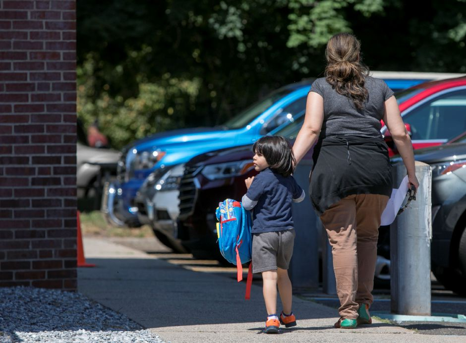 A student is picked up at the Women and Families Center in Meriden, Thursday afternoon, June 21, 2018. Funding for the School Readiness Program will end on August 24, 2018. Dave Zajac, Record-Journal