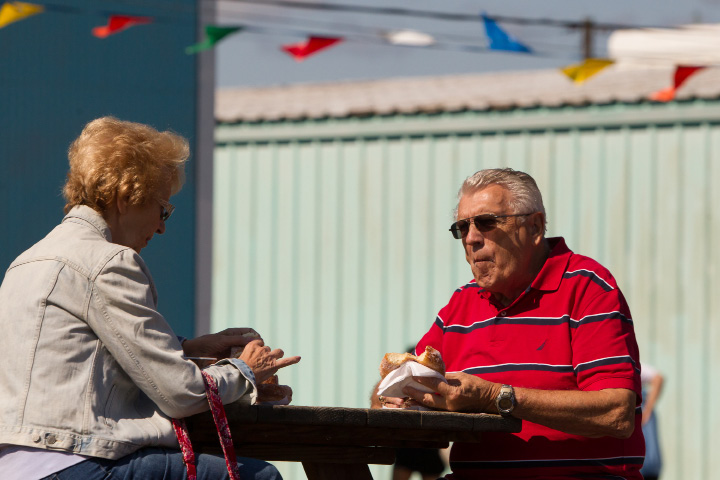 Elanor and Lenny Galushko of East Haven enjoys a big doughnut and coffee  Sunday during the 75th Annual North Haven Fair in North Haven September 10, 2017 | Justin Weekes / For the Record-Journal