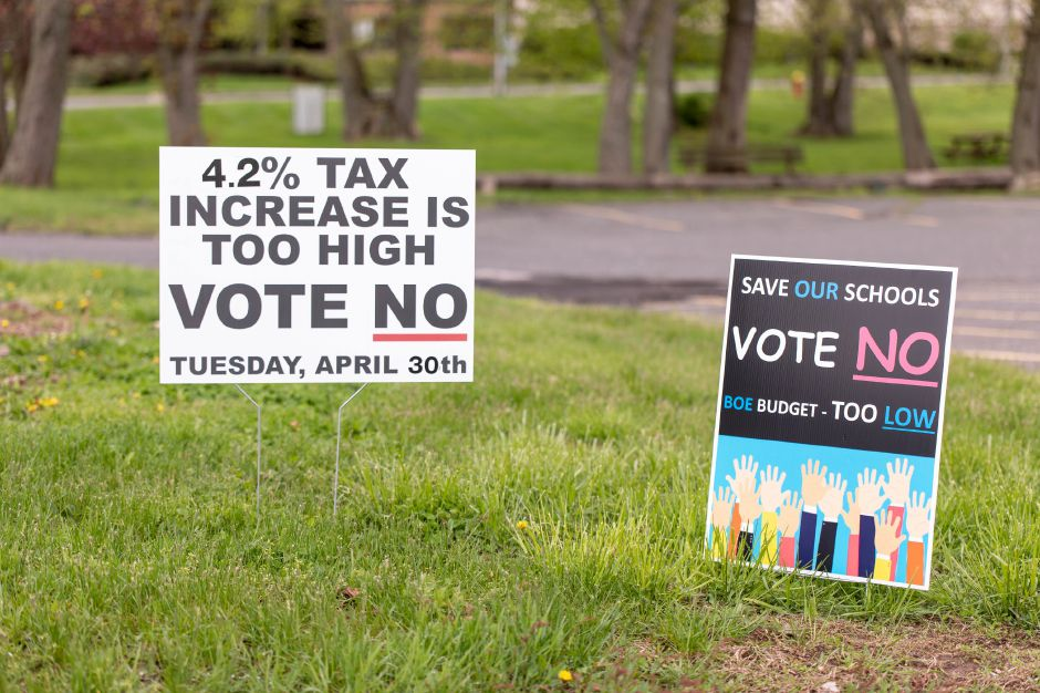 Political signs outside the polling location at the Berlin American Legion during the April 30, 2019 budget referendum. Voters narrowly rejected the school budget as too low, while voting against the municipal budget as too high. | Devin Leith-Yessian/Berlin Citizen