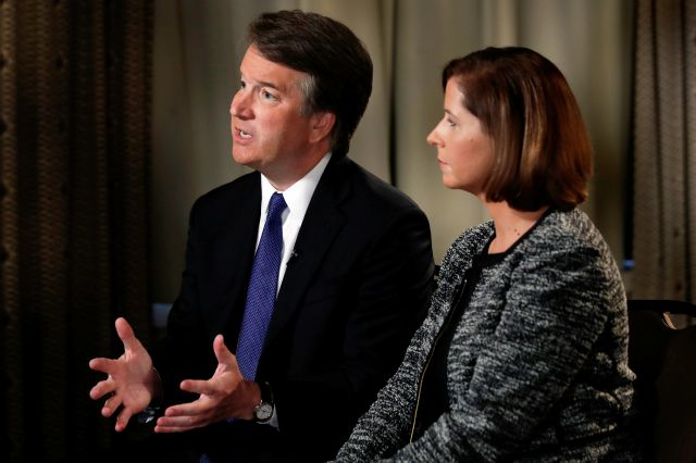 Brett Kavanaugh, with his wife Ashley Estes Kavanaugh, answers questions Monday in Washington during a FOX News interview about allegations of sexual misconduct against the Supreme Court nominee. Associated Press