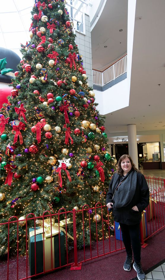 Mayra Martinez, of St. Cloud, FL, stands next to a Christmas tree as daughter, Amanda, snaps a photo at Westfield Meriden mall, Tuesday, Nov. 14, 2017. | Dave Zajac, Record-Journal