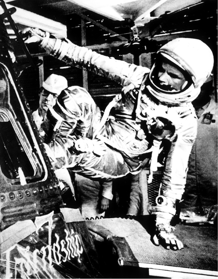 FILE – In this Feb. 20, 1962, file photo, U.S. astronaut John Glenn climbs inside the capsule of the Mercury spacecraft Friendship 7 before becoming the first American to orbit the Earth, at Cape Canaveral Air Force Station in Cape Canaveral, Fla. John Glenn is continuing to inspire 55 years after becoming the first American to orbit Earth. The anniversary of the flight is Monday, Feb. 20, 2017. (AP Photo/File)