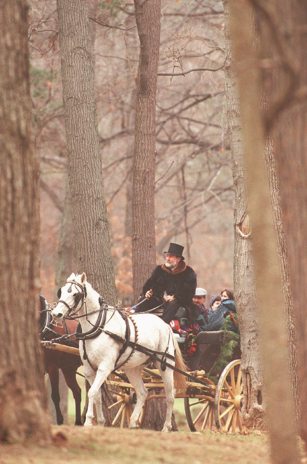 RJ file photo - John Allegra of Allegra Farms in East Haddam drives on of the carriages filled with passengers through Hubbard Park during the 11th annual Christmas in the Park celebration Dec. 13, 1998.