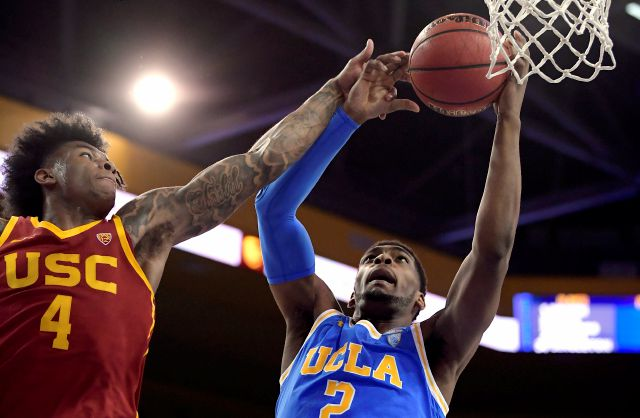 FILE - In this Feb. 28, 2019, file photo, UCLA forward Cody Riley, right, grabs a rebound away from Southern California guard Kevin Porter Jr. during the first half of an NCAA college basketball game in Los Angeles. The NCAA's Board of Governors is urging Gov. Gavin Newsom not to sign a California bill that would allow college athletes to receive money for their names, likenesses or images. In a six-paragraph letter to Newsom, the board said the bill would give California schools an...