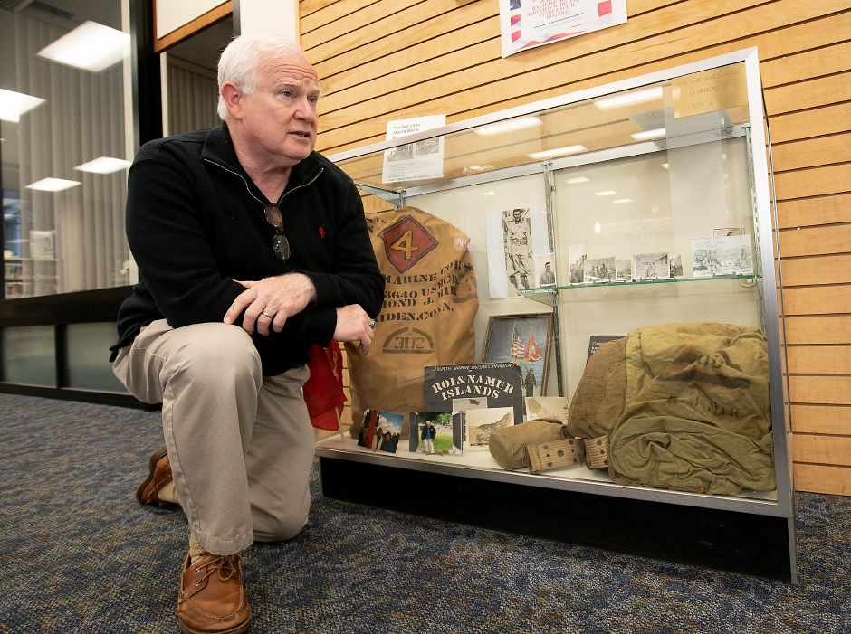 Jerry Maust, reference librarian, talks about a display of Iwo Jima-related materials at the Meriden Public Library on Thursday. The materials belonged to Raymond Mik, USMC who served in World War II in the Pacific from 1942-1945.Photos by Dave Zajac, Record-Journal