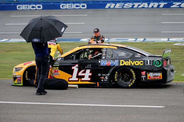 Clint Bowyer (14) sits in his car during a rain delay in a NASCAR Cup Series auto race at Talladega Superspeedway in Talladega, Ala., Sunday, Oct. 13, 2019. (AP Photo/Butch Dill)