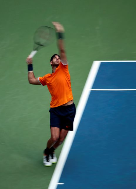 Juan Martin del Potro, of Argentina, serves to John Isner during the quarterfinals of the U.S. Open tennis tournament, Tuesday, Sept. 4, 2018, in New York. (AP Photo/Andres Kudacki)