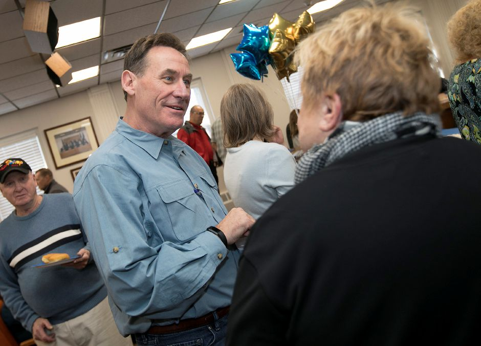 Town Manager Garry Brumback talks with Cheryl Lounsbury, former council vice chairwoman, during his retirement party at Southington Town Hall, Friday, Nov. 17, 2017. | Dave Zajac, Record-Journal