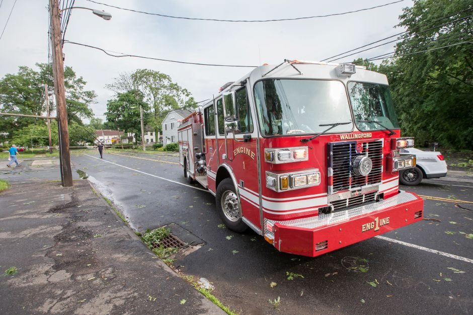 Wallingford Fire Department Engine 1 heads out from the Center Street call to respond to another of numerous calls due to a thunder storm Tuesday in Wallingford Jun. 23, 2015 | Justin Weekes / For the Record-Journal