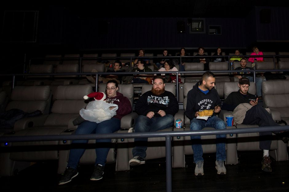 Movie-goers trickle in to one of several sold-out theaters at Holiday Cinemas in Wallingford for the premiere of Star Wars: The Last Jedi Dec. 14, 2017. | Richie Rathsack, Record-Journal staff