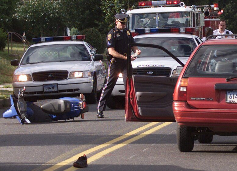 Then Meriden police Sgt. Larry Guidobono at the scene of a scooter vs. car accident on Linsley Ave. in this undated file photo.