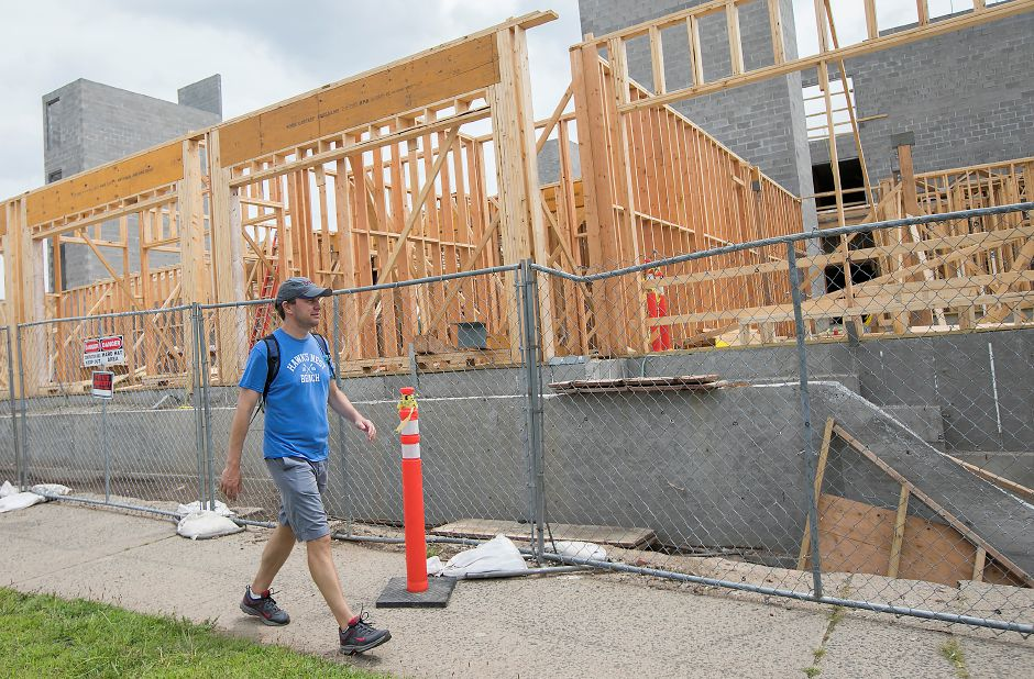 U.S. Senator Chris Murphy passes the Meriden Commons construction site at the corner of Mill Street and State Street in Meriden during his walk across Connecticut, Tuesday, August 15, 2017. | Dave Zajac, Record-Journal