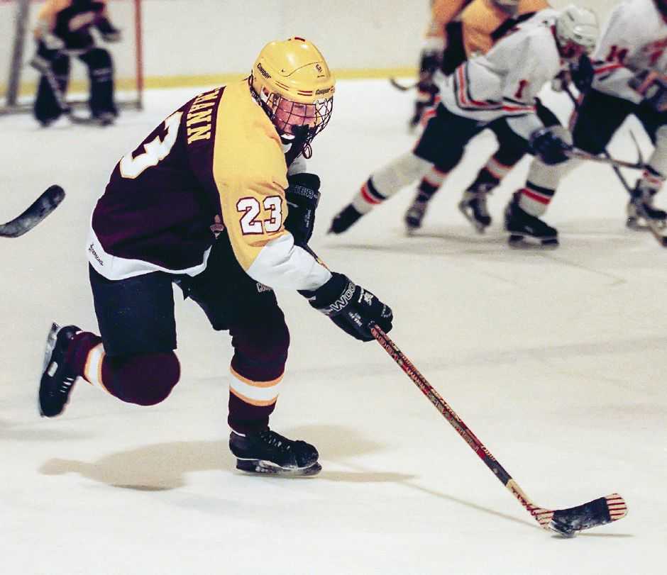 RJ file photo - Sheehan forward Stephen Tiedemann skates the puck up the ice against Lyman Hall Jan. 20, 1999 in the Choate rink.