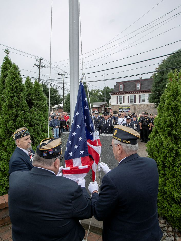 Veterans from American Legion Post 72, left to right, Steve Pintarich, Norm Giroux and Steve McCarty, raise the American flag during the annual 9/11 remembrance ceremony in Southington, Tuesday, Sept. 11, 2018. Dave Zajac, Record-Journal