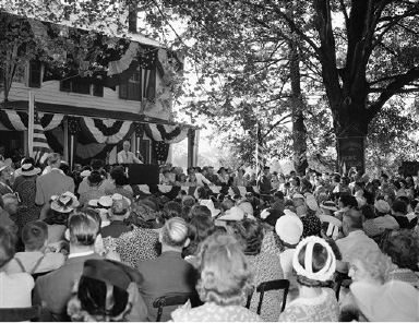 President Franklin d. Roosevelt, speaking on platform, addresses friends and neighbors at his Hyde Park, New York estate, Aug. 30, 1941. (AP Photo)
