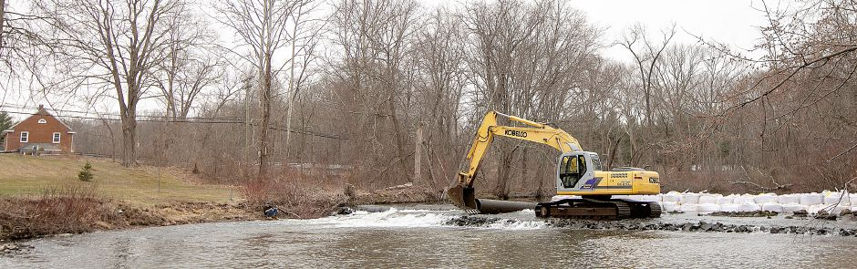A worker maneuvers an excavator while working on the final phase of the Quinnipiac River barrier removal project in Meriden, Fri., Apr. 5, 2019. Dave Zajac, Record-Journal