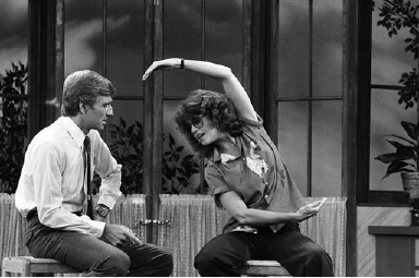 Actress Jane Fonda shows host Garry Collins some stretching exercises during visit to the locally produced ?Hour Magazine? television program in Los Angeles on Wednesday, Oct. 22, 1981.   The segment was taped for syndicated showing on December 2. (AP Photo/Nick Ut)