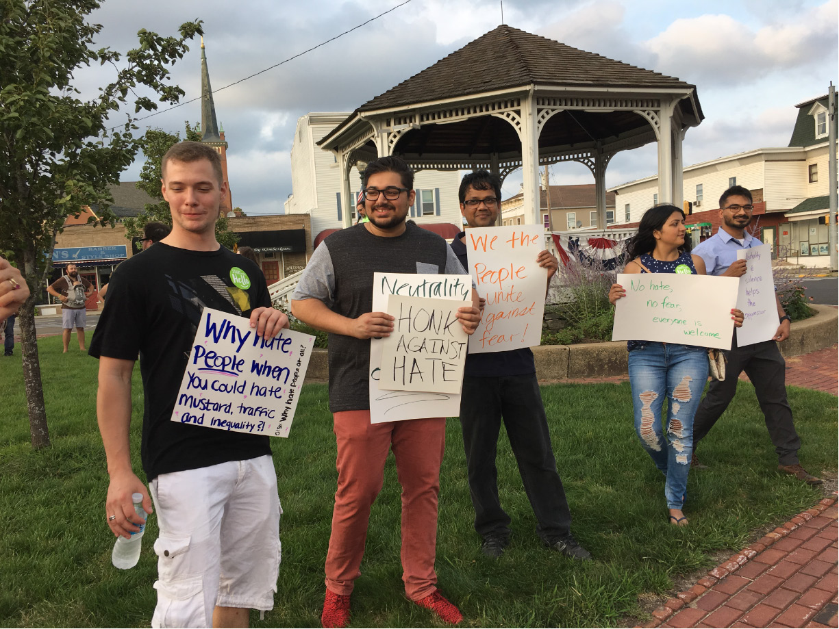 About 40 people attended a locally organized rally against racism and other forms of discrimination at Johanna Manfreda Fishbein Park on Tuesday, Aug. 22, 2017. | Lauren Takores, Record-Journal