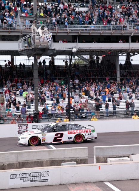 NASCAR Cup Series driver Brad Keselowski (2) takes the checkered flag as he wins the NASCAR Brickyard 400 auto race at Indianapolis Motor Speedway, in Indianapolis Monday, Sept. 10, 2018. (AP Photo/AJ Mast)