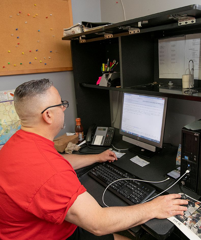 John Gawlak, director of Wallingford Parks and Recreation, works at his desk, Fri., May 3, 2019. Gawlak is leaving after more than three decades to take a similar position in Cheshire later this month. Dave Zajac, Record-Journal