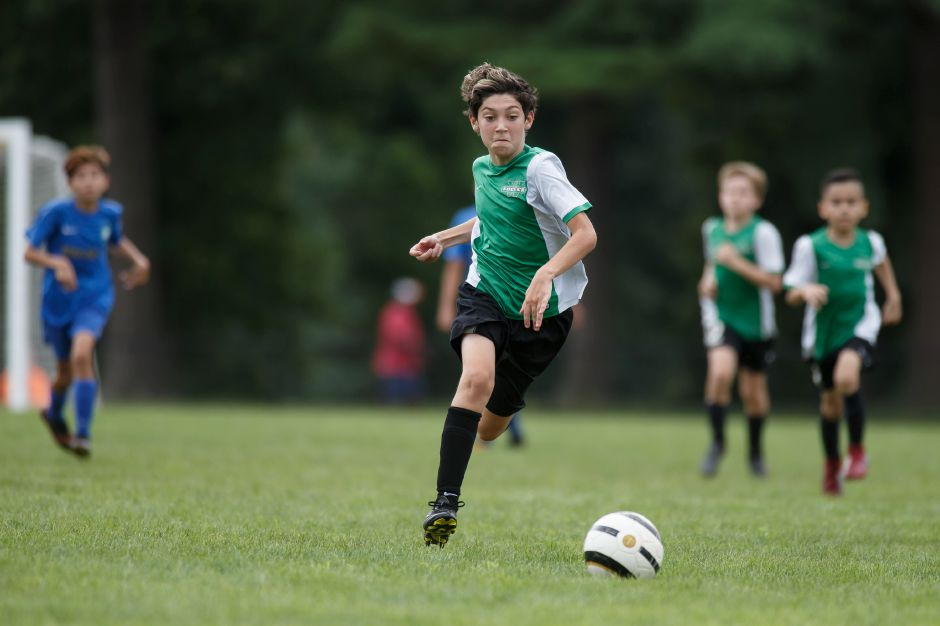 FILE – Wallingford Warriors Dominic Collela chases down a loose ball Sunday during the annual TWIST soccer tournament at Choate Rosemary Hall in Wallingford August 19, 2018 | Justin Weekes / Special to the Record-Journal