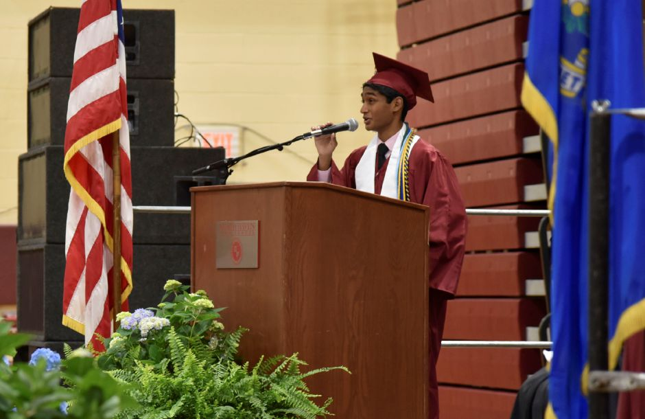 Class President Jobin Valiyaveettil gives greetings during the North Haven High School graduation ceremonies indoors at the school on June 13, 2019. | Bailey Wright, Record-Journal
