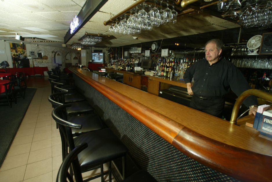 Ron Vumback A Bartender At The Cabin Restaurant In Meriden Waits For Patrons During Hy