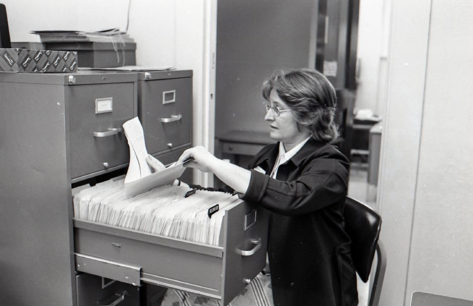 A records clerk at the Meriden-Wallingford Hospital sifts through files, May 1975.