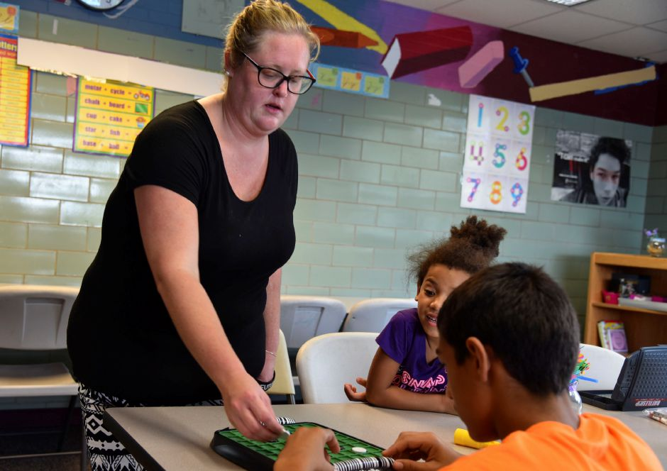 Emily Mulligan, coordinator of volunteers and the mentorship program at the Boys & Girls Club in Meriden, plays Othello with a student at the club on Wednesday, Sept. 19. Mulligan is hoping to expand the mentorship program. | Bailey Wright, Record-Journal