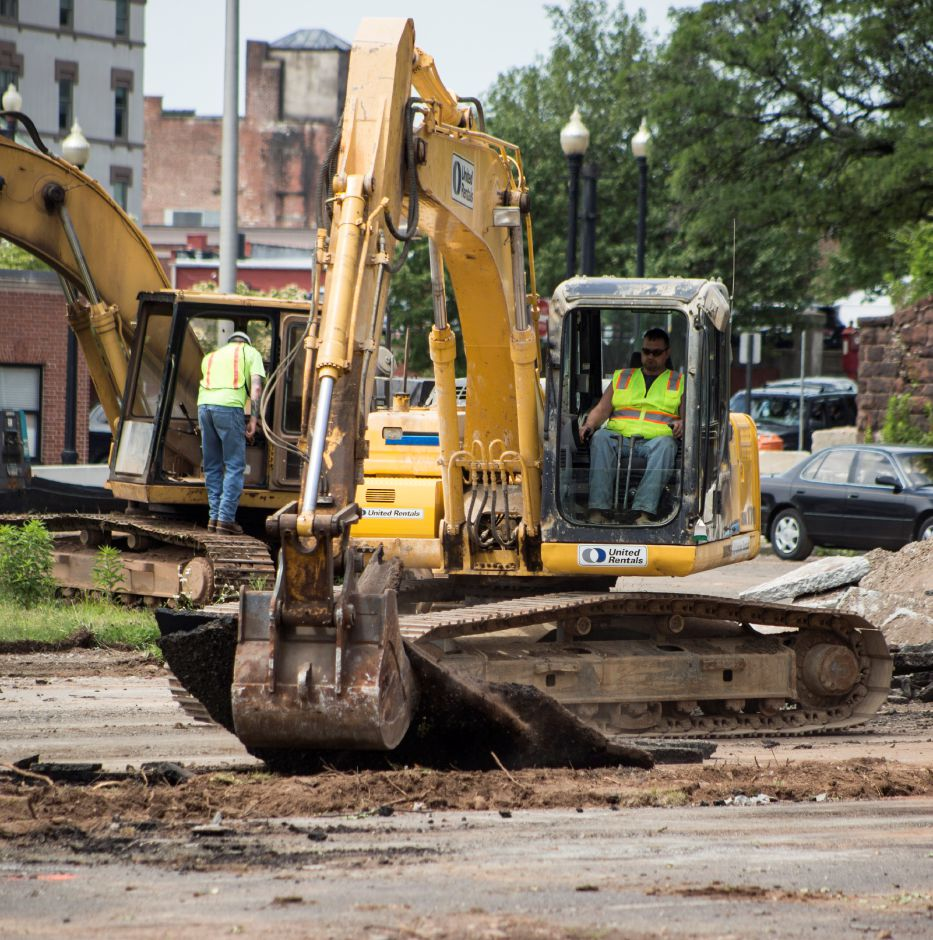 An excavator rips up pavement from the parking lot at 24 Colony St. in Meriden Thursday June 18, 2015. | Richie Rathsack/Record-Journal