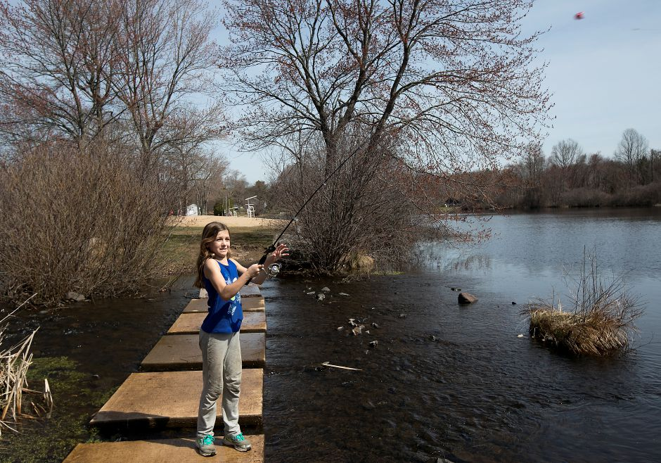 Eva Curran, 10, of Cheshire, casts a line into Mixville Pond on a warm day in Cheshire, Tuesday, April 11, 2017. Temperatures reached a record breaking 85 degrees Tuesday afternoon. The previous record high for April 11 was 79 degrees, set in 1955. | Dave Zajac, Record-Journal