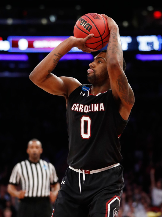 South Carolina guard Sindarius Thornwell (0) takes a shot against South Carolina in the first half of an East Regional semifinal game against Baylor in the NCAA men