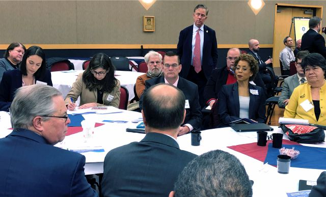 Incoming Connecticut Gov. Ned Lamont, standing, listens to members of one of the 15 transition public policy groups he formed to help provide recommendations for his new administration, Tuesday, Nov. 27, 2018, at Eastern Connecticut State University in Willimantic, Conn. This group of more than 450 people gathered to offer education-related proposals. (AP Photo/Susan Haigh)