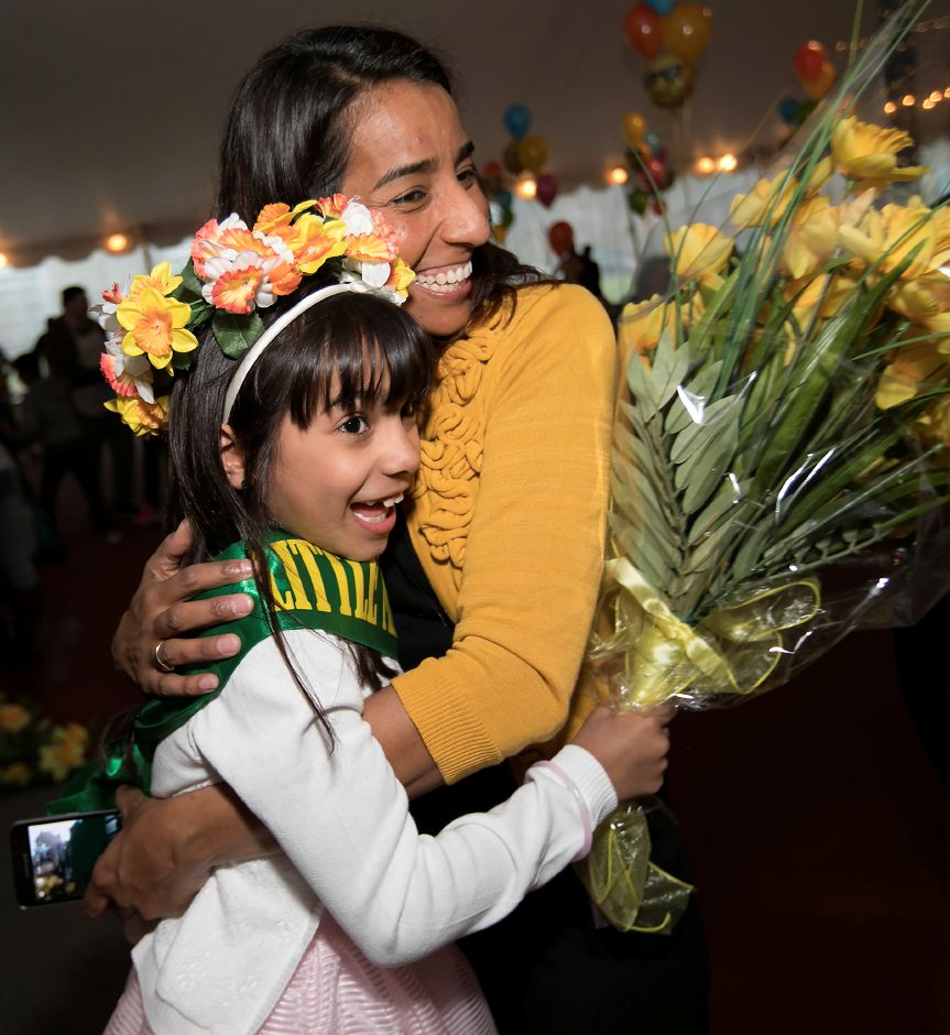 Sophia Rivera, 7, of Meriden, smiles with her mother, Sonia Garcia-Rivera, after being crowned Little Miss Daffodil at Hubbard Park in Meriden on April 26.Dave Zajac, Record-Journal