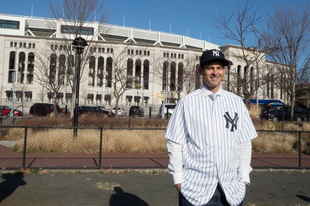 Aaron Boone, the new manager of the New York Yankees, poses outside Yankee Stadium after an introductory news conference Wednesday in New York. Associated Press