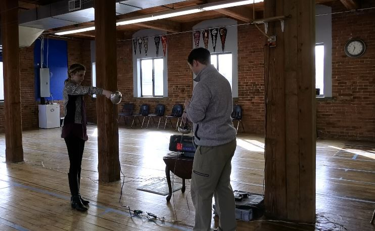 Record-Journal Digital Content Producer Ashley Kus tries out fencing with Kyle Mezzi, owner and coach of Silver City Fencing Club, 340 Quinnipiac St., Wallingford. |Ashley Kus, Record-Journal