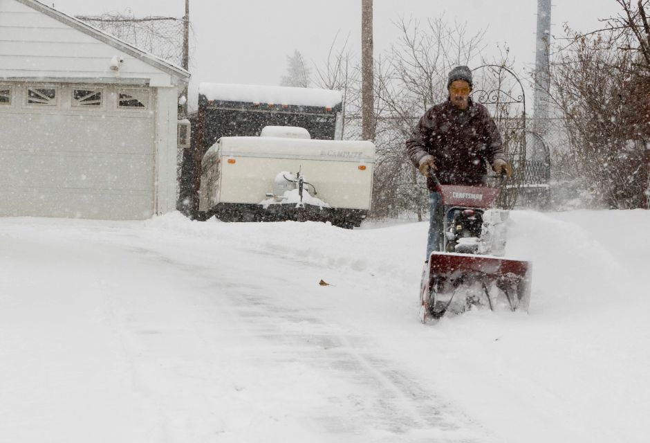 Brad Boissonneault [cq] uses a snowblower to clear the driveway of his home in Meriden, Dec. 31, 2008. The snow storm drop several inches of snow throught Meriden and surrounding towns. (Christopher Zajac/Record-Journal)