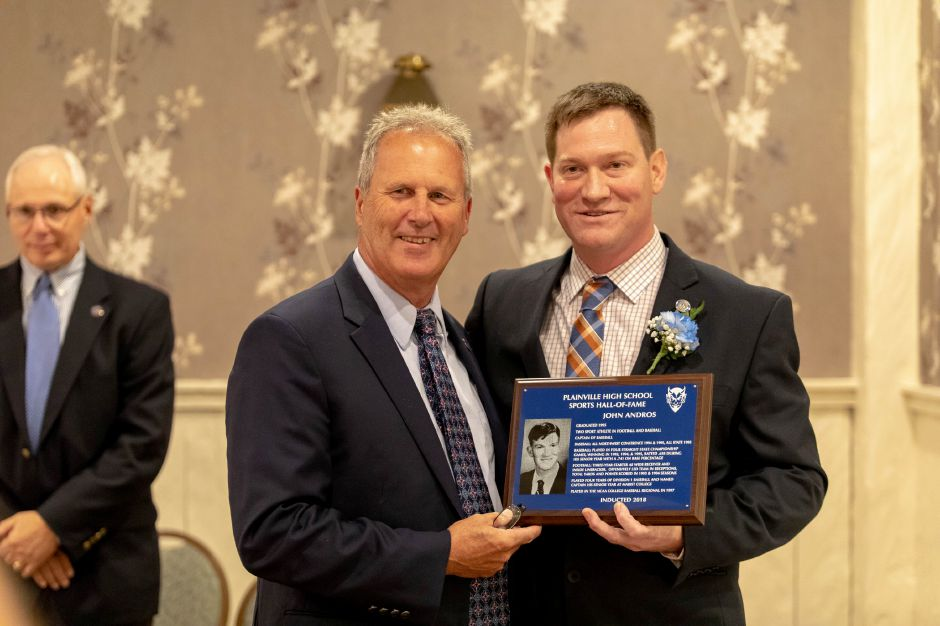 Plainville High School baseball player John Andros, right, was inducted into the Plainville Sports Hall of Fame on Oct. 6, 2018. | Devin Leith-Yessian/Plainville Citizen