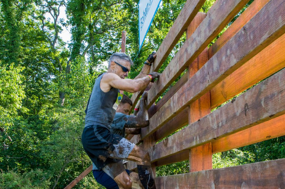 Participants of the Gaylord Gauntlet 5k walk and run step under wires, climb up walls and run through mud Saturday across an obstacles at the Gaylord Hospital campus in Wallingford, Mon., June 22, 2019. Jim McGovern, Special to the Record-Journal.