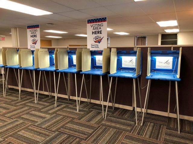 Voting booths stand ready in downtown Minneapolis for the opening of early voting in Minnesota. Minnesota and South Dakota are tied for the earliest start in the country for early voting in the 2018 midterm elections. A new poll finds that a large majority of Americans are concerned the nation's voting systems might be vulnerable to hackers, with Democrats more concerned than Republicans. (AP Photo/Steve Karnowski)